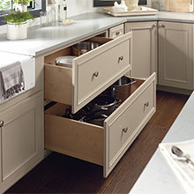 Two drawer base cabinet with both drawers open to show storage inside