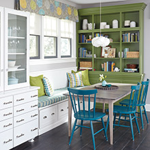 White and green cabinets in a dining area