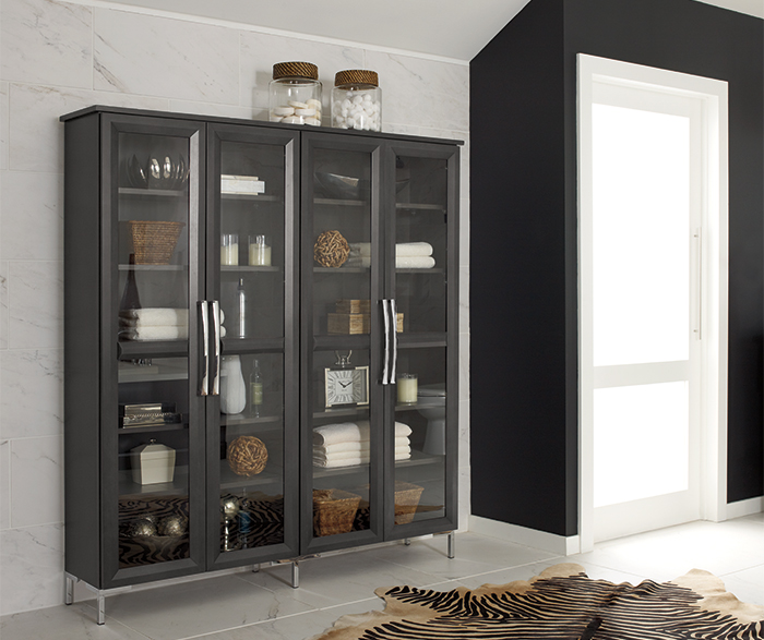 Bathroom storage cabinet with glass doors by Decora Cabinetry