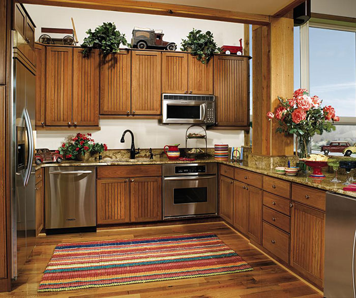 Beadboard cabinets in a rustic kitchen by Decora Cabinetry