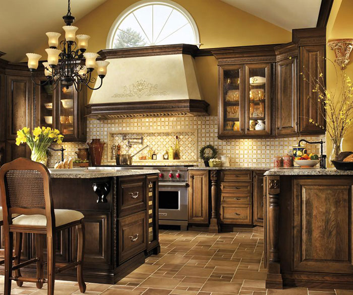 U shaped kitchen design with Cherry cabinets by Decora Cabinetry