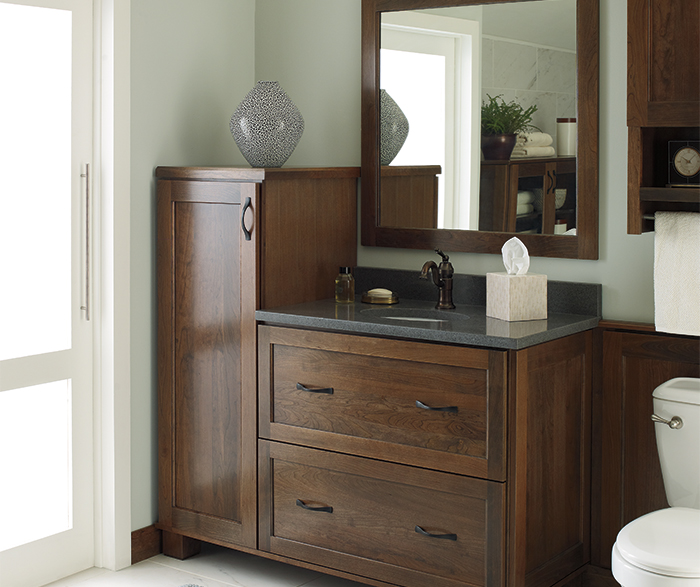 Cherry vanity cabinet by Decora Cabinetry
